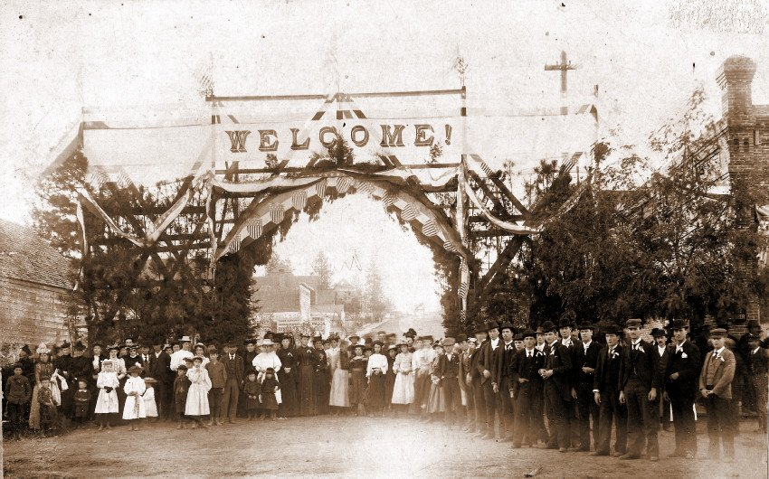 Dignitaries and residents are welcomed at the foot of Normal Ave [College Ave] on October 15, 1895.