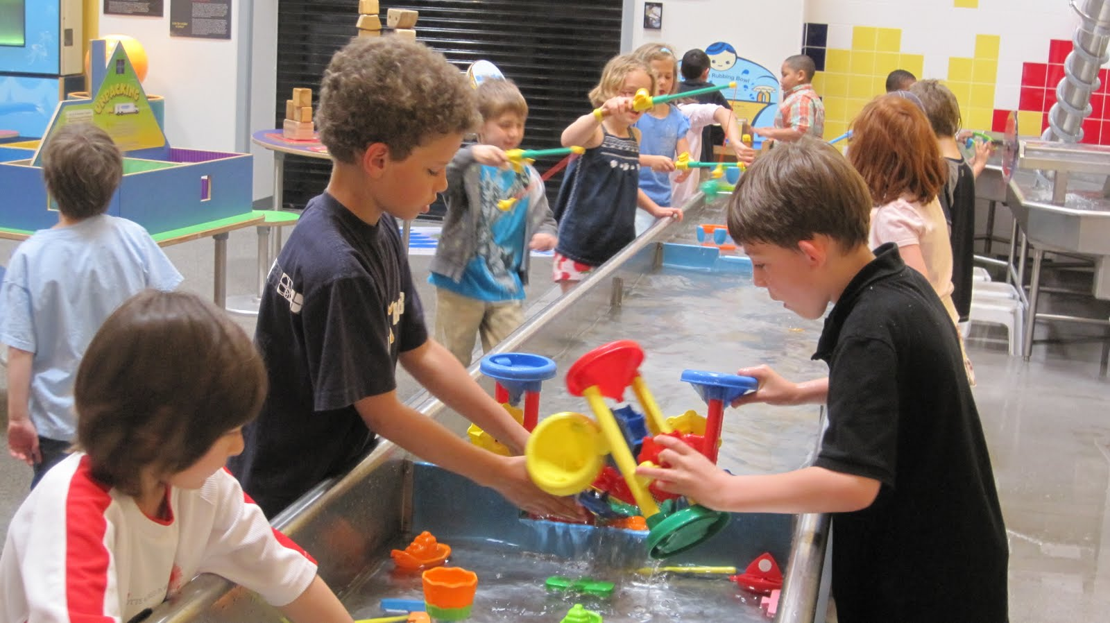 Children love to play in the water tables at the Water Gallery