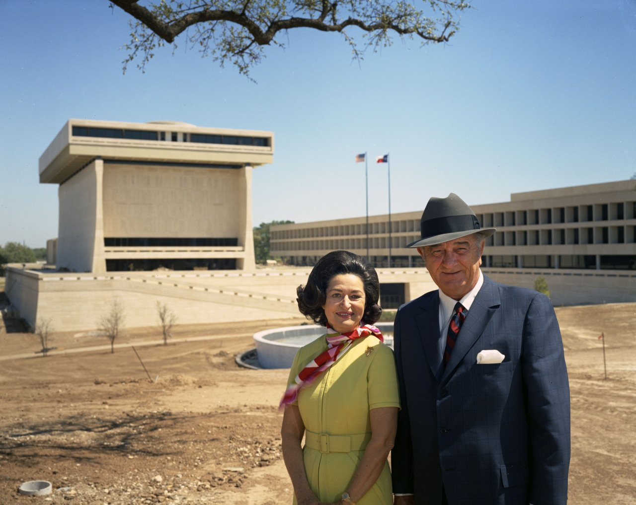 Lyndon and Lady Bird Johnson posing in front of the new Lyndon Baines Johnson Library and Museum both took an active role in planning