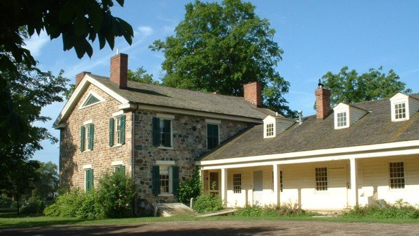 Back view, showing how the 1844 cobblestone building was added to the original 1830s frame home