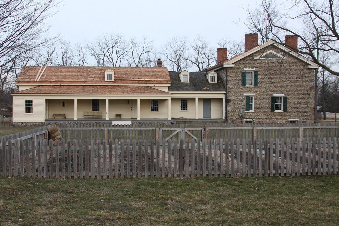 Side view of the 1830s frame home attached to the 1844 cobblestone front addition