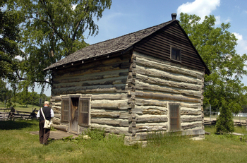 An authentic 1830s log cabin, moved to the site in the 1980s piece-by-piece