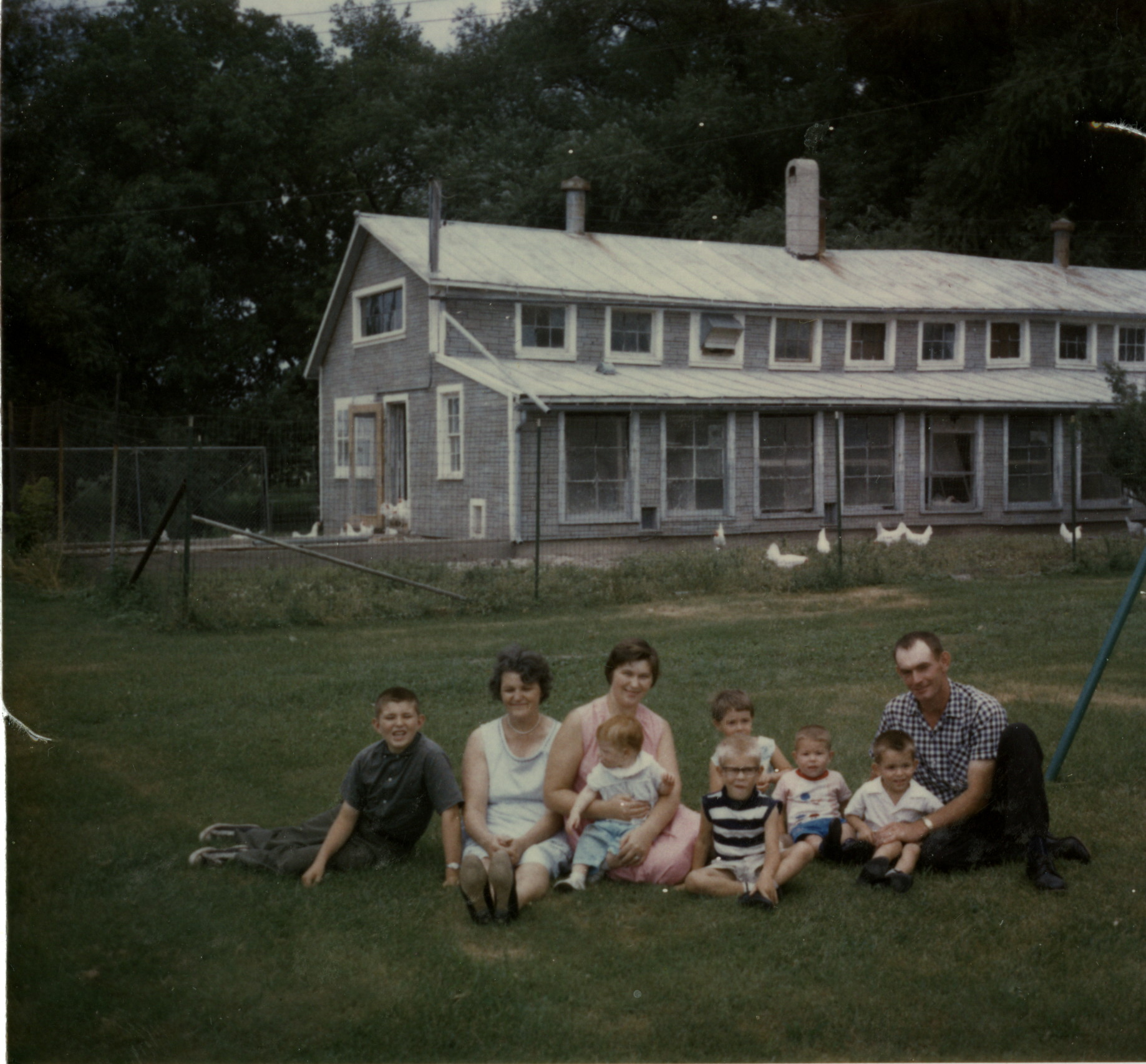 Alex and Marlene Kraus pose with their family on St. Joseph Springs Farm, c. 1967.  Alex and his brother Marvin managed the farm in the 1960s.