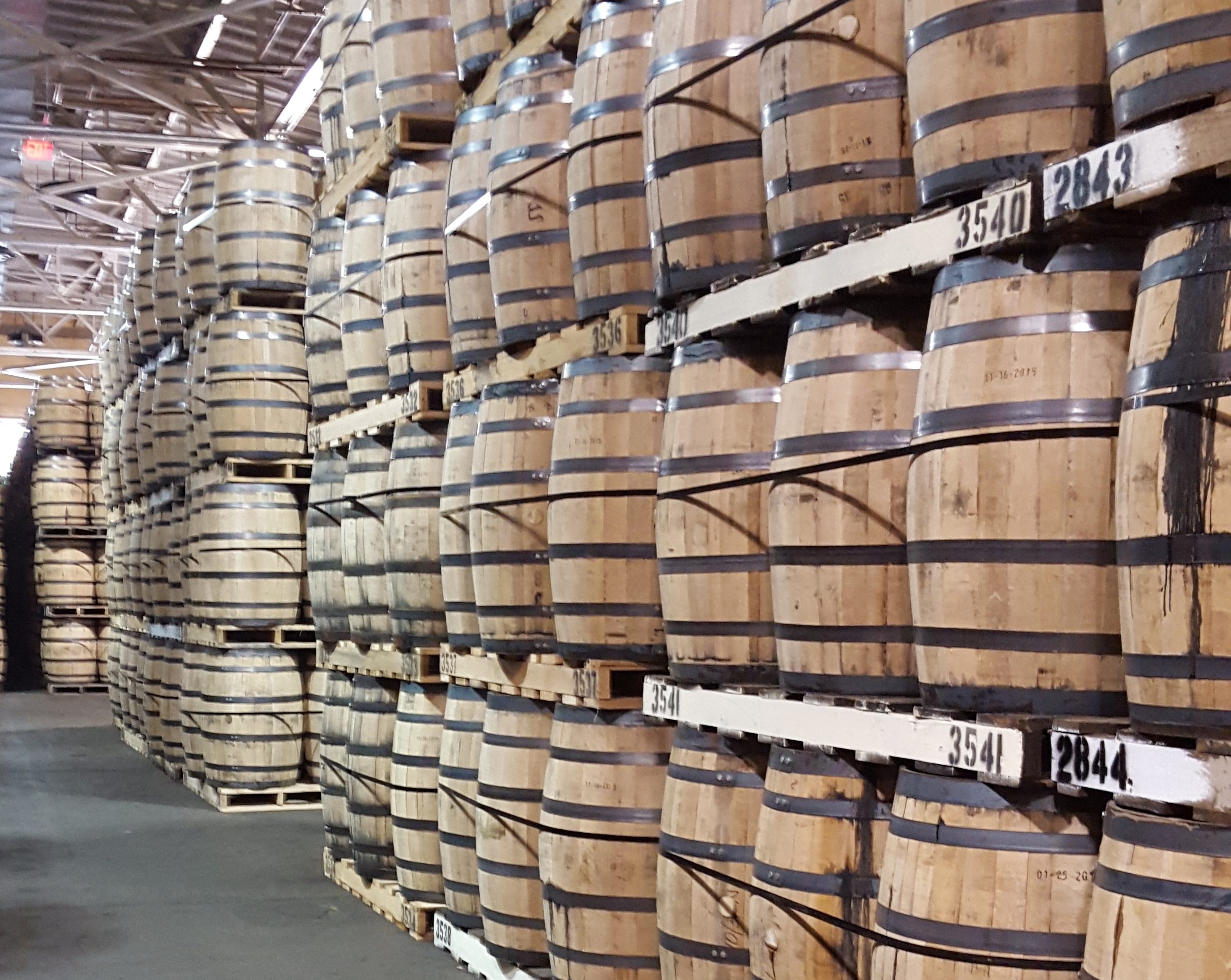 Aging spirits in oak barrels at the A. Smith Bowman Distillery