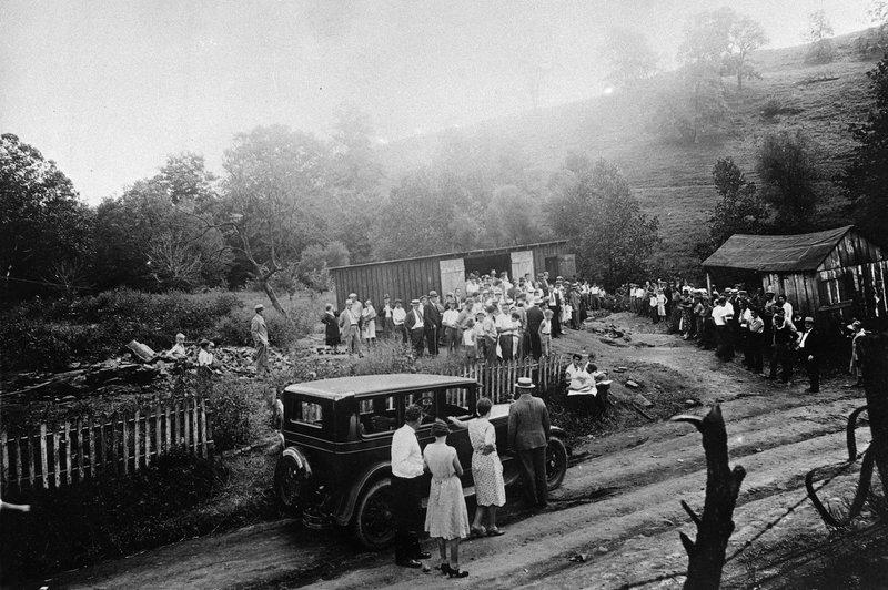 "Community gathering around the ""murder barn"""