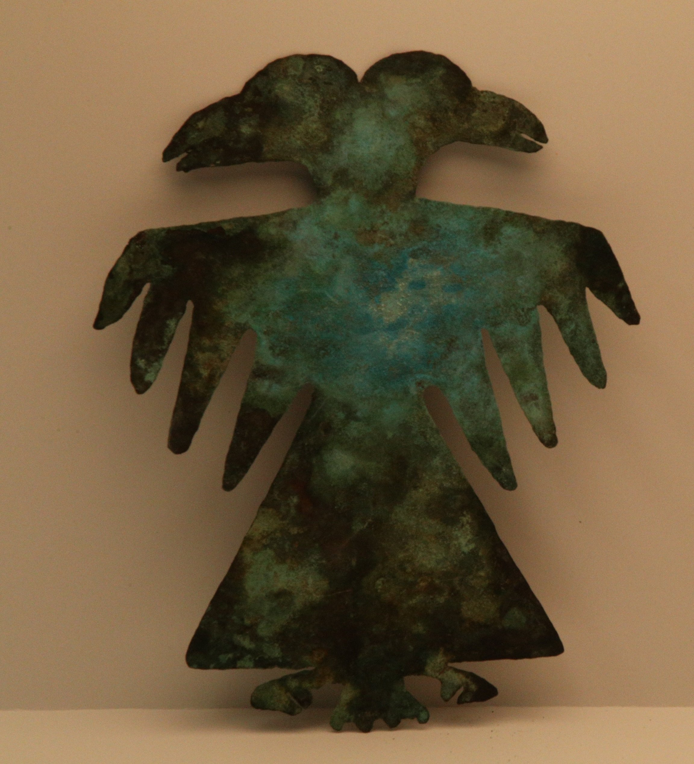 Pictured is a double headed copper bird effigy. Avian themed copper plates were thought to depict aspects of The Birdman, a major figure in Mississippian iconography closely associated with warfare and ritual dancing