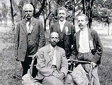 Niagara Movement leaders W. E. B. Du Bois (seated), and (left to right) J. R. Clifford, Lafayette M. Hershaw, and Freeman H. M. Murray at Harpers Ferry.