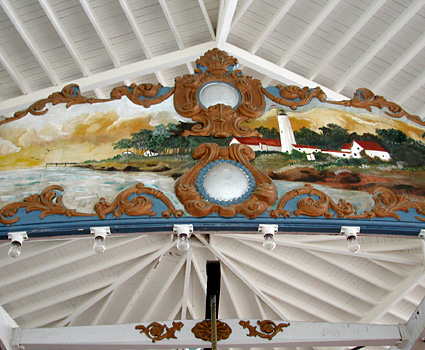 A painting of a view of New Haven harbor on the surface of the carousel