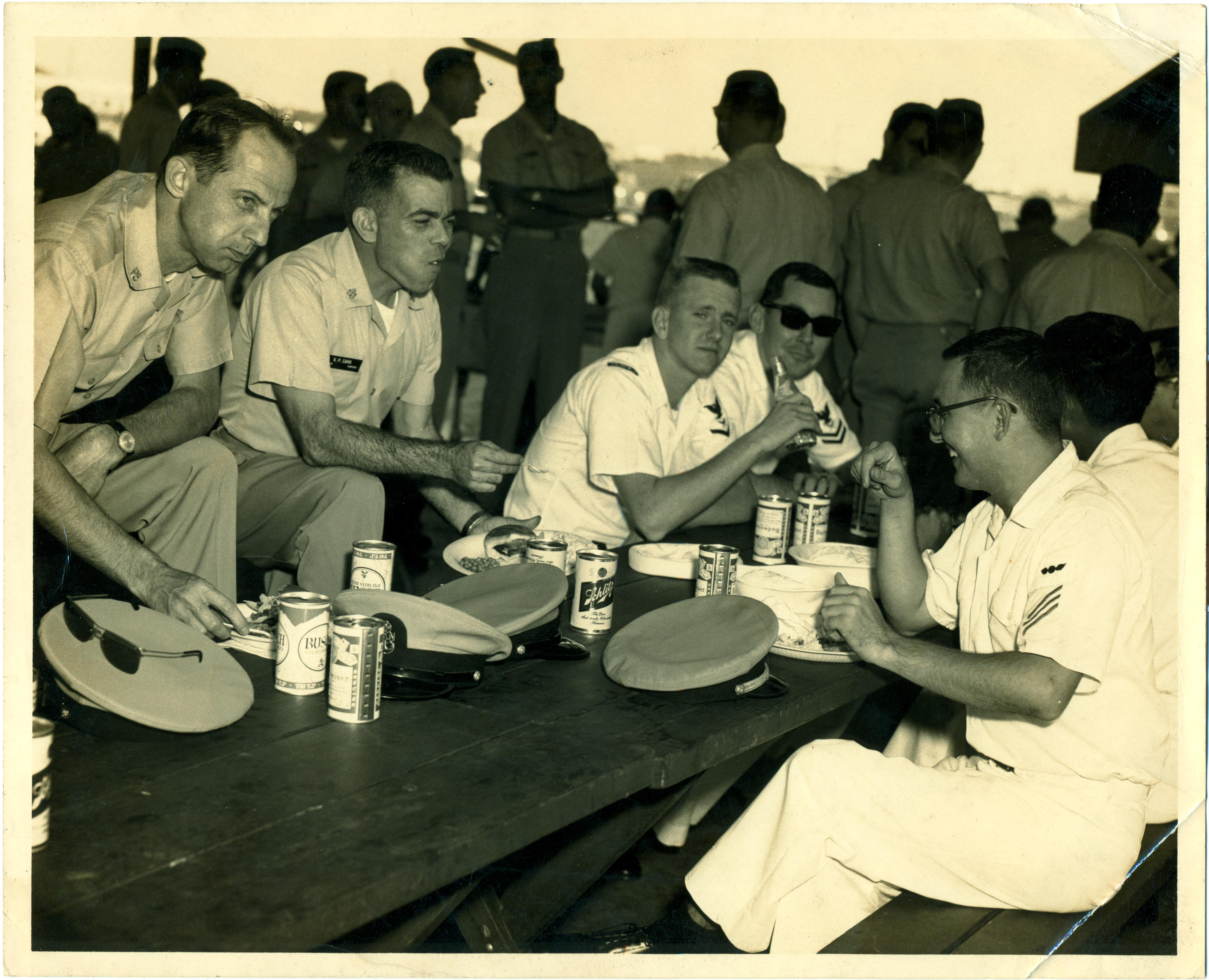Inspection committee members enjoying a lunch on the base.