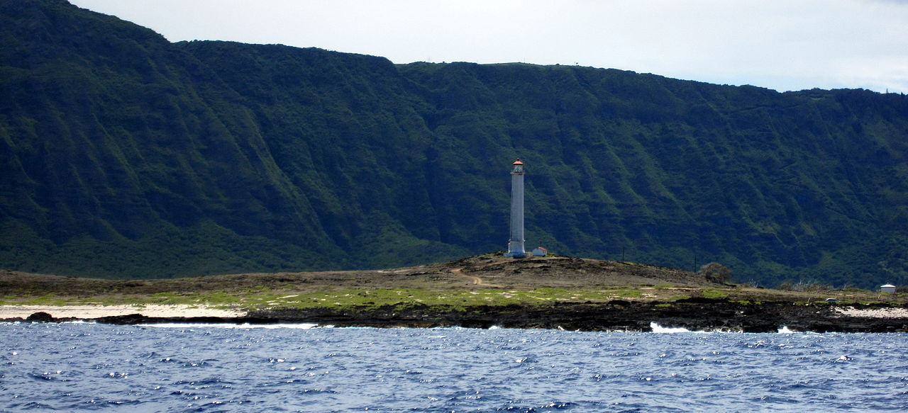 The light as seen from the water. The cliffs in the background rise 3,000ft high.   Photo by: Mahalo Michael