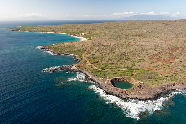 Aerial view of the island. The small round feature on the bottom is actually a crater left from an exploding bomb.