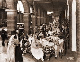 A wedding party held in El Pasaje's arcade. Circa late 1800s, early 1900s.