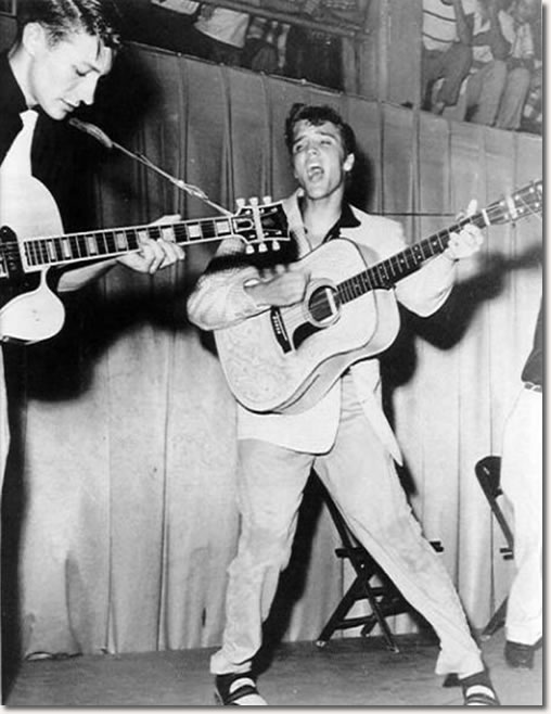 A now iconic photo of Elvis, this was taken during his performance at the armory. To the left is Scotty Moore