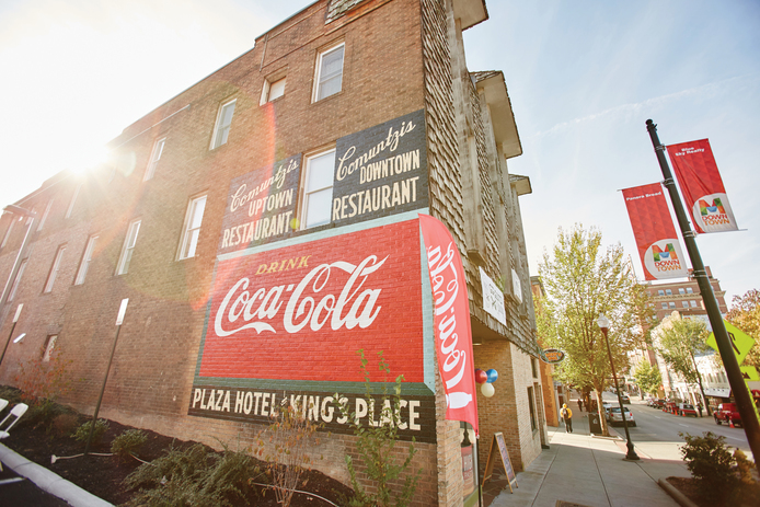 Newly restored Coca-Cola mural on what is now High Street Pasta Co.