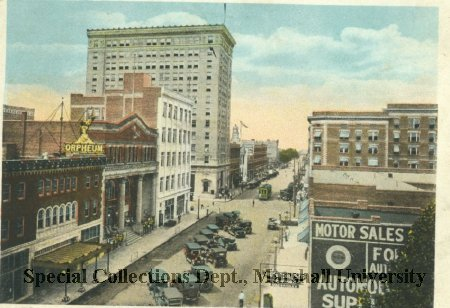 Circa 1915 postcard of 4th Avenue looking west, with the white Day and Night Bank visible on the left. Courtesy of Marshall University Special Collections.