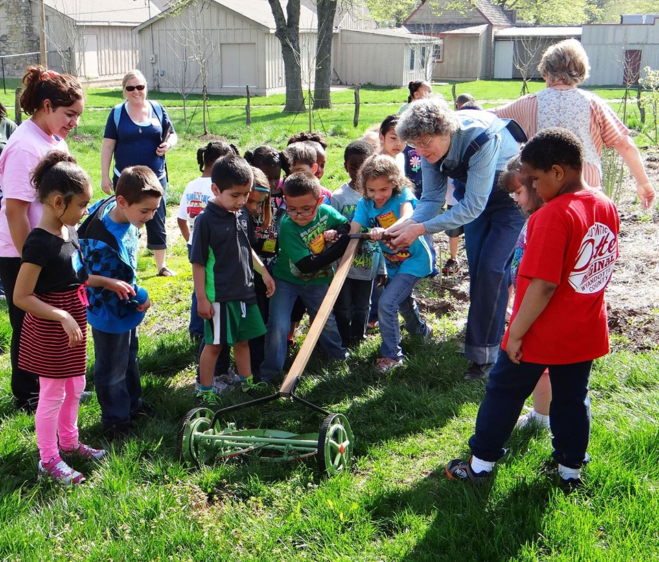 A school group learns about life on the farm