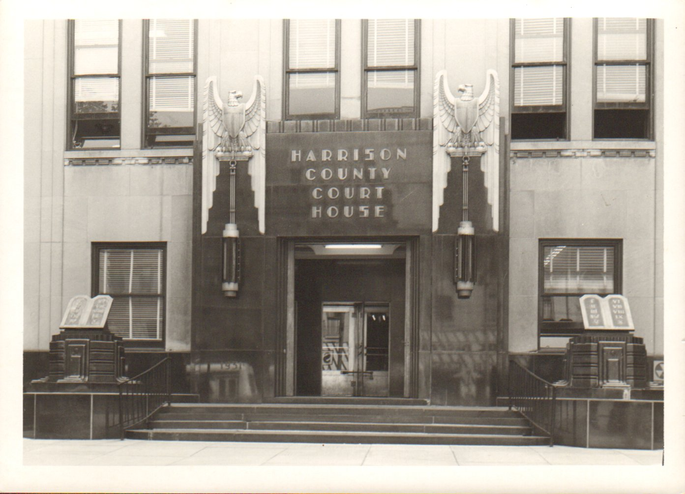 Black and white photograph of the front entrance to the Harrison County Courthouse that was completed in 1932. 