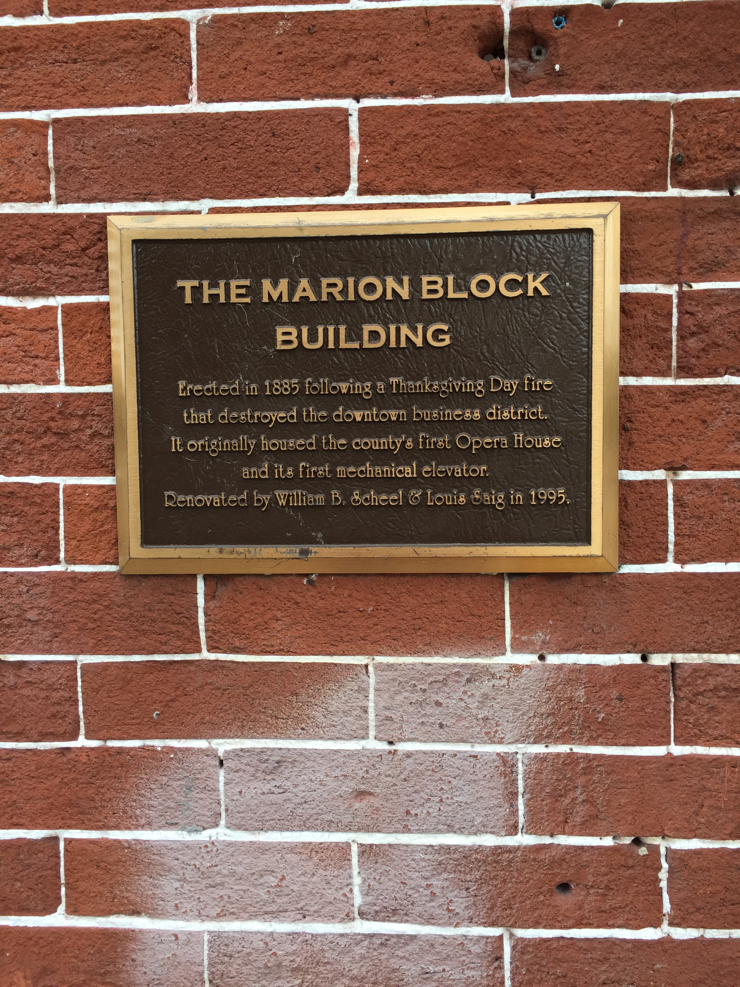 Plaque located on the 1st Ave side of building