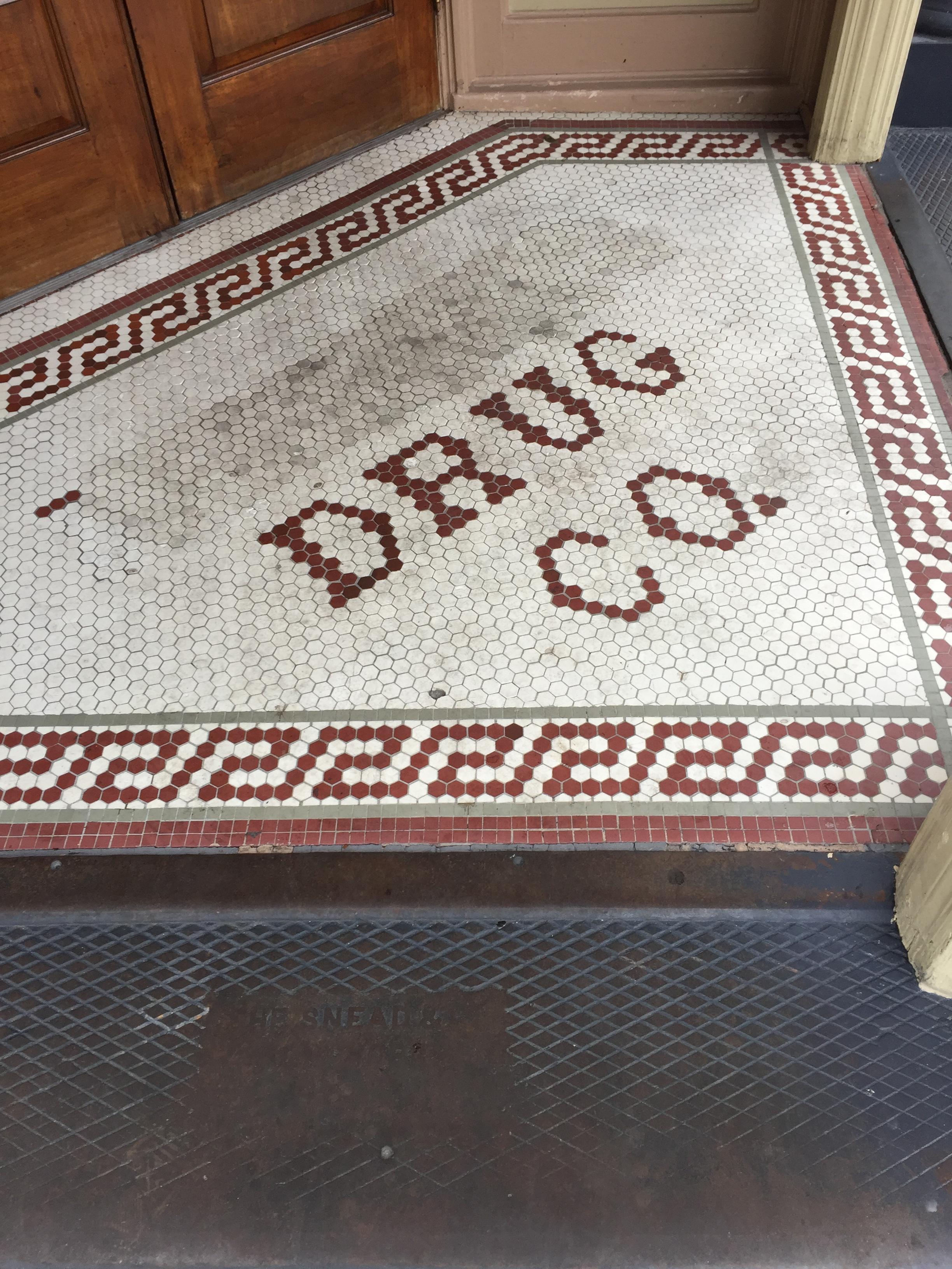 Original mosaic floor when entering Harry's Seafood