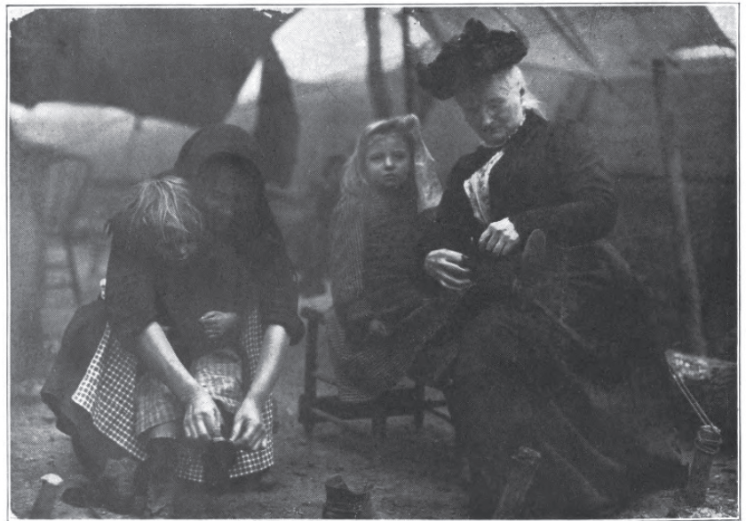 Mother Jones (far right) assisting miners' children.  Jones was a prominent union organizer of her day, and a key figure in the strikes that led to the Mine Wars.