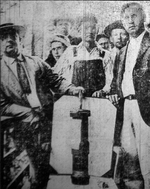 Miners pose with one of the bombs dropped on them during the Battle of Blair Mountain.  Evidence that such brutality was employed by coal companies during the uprising was a powerful PR tool for unions in the aftermath of the battle.