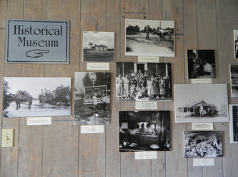 Photos of early settlers and farmers displayed in the museum.