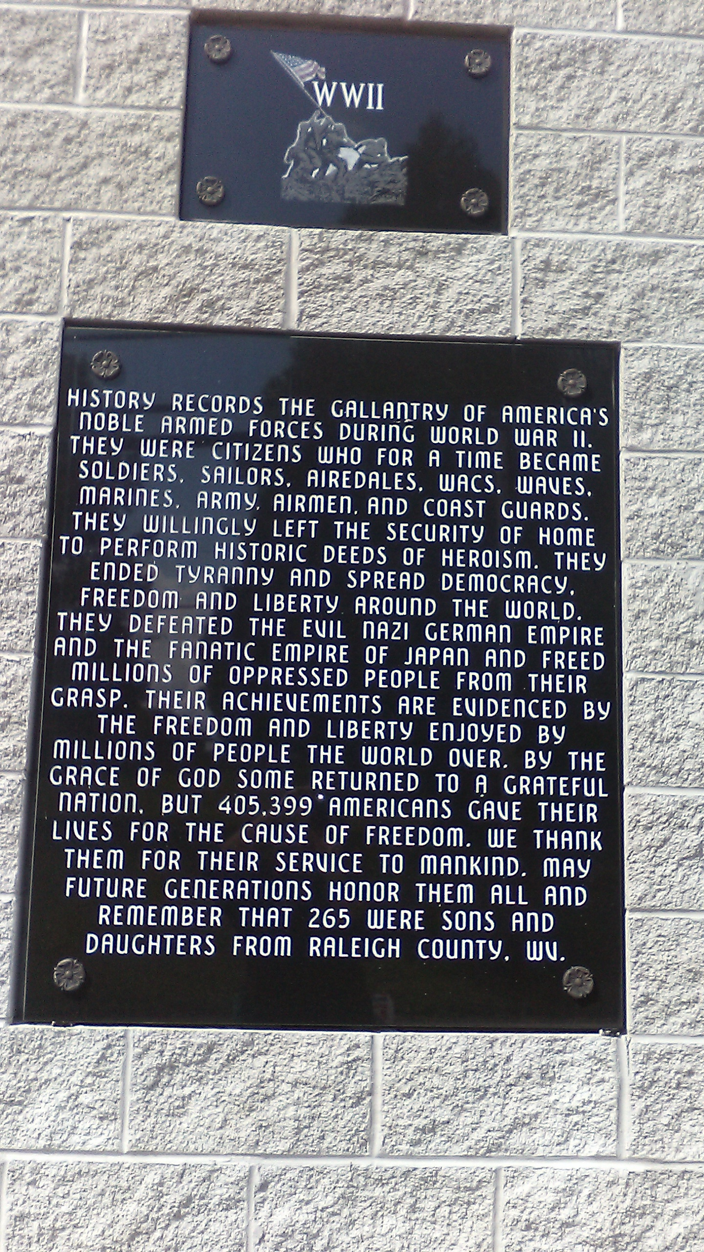 Picture is of front panel with inscription honoring the 265 men and women from Raleigh County, WV who died during World War II