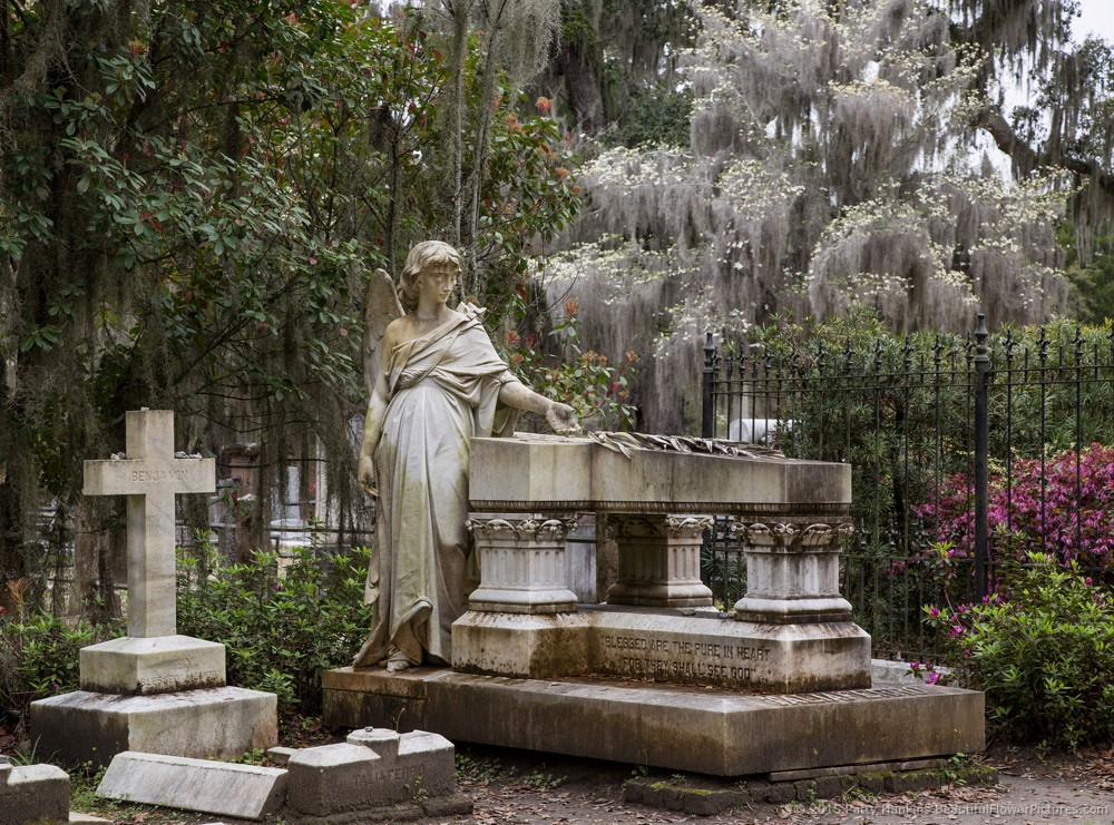 The cemetery features many stone statues and graves such as these.