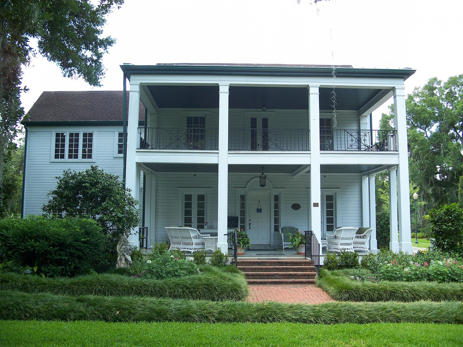 The Mizell-Leu House was first built in 1888 and was expanded significantly over the coming decades by subsequent owners. The building in the street view is the Welcome Center.