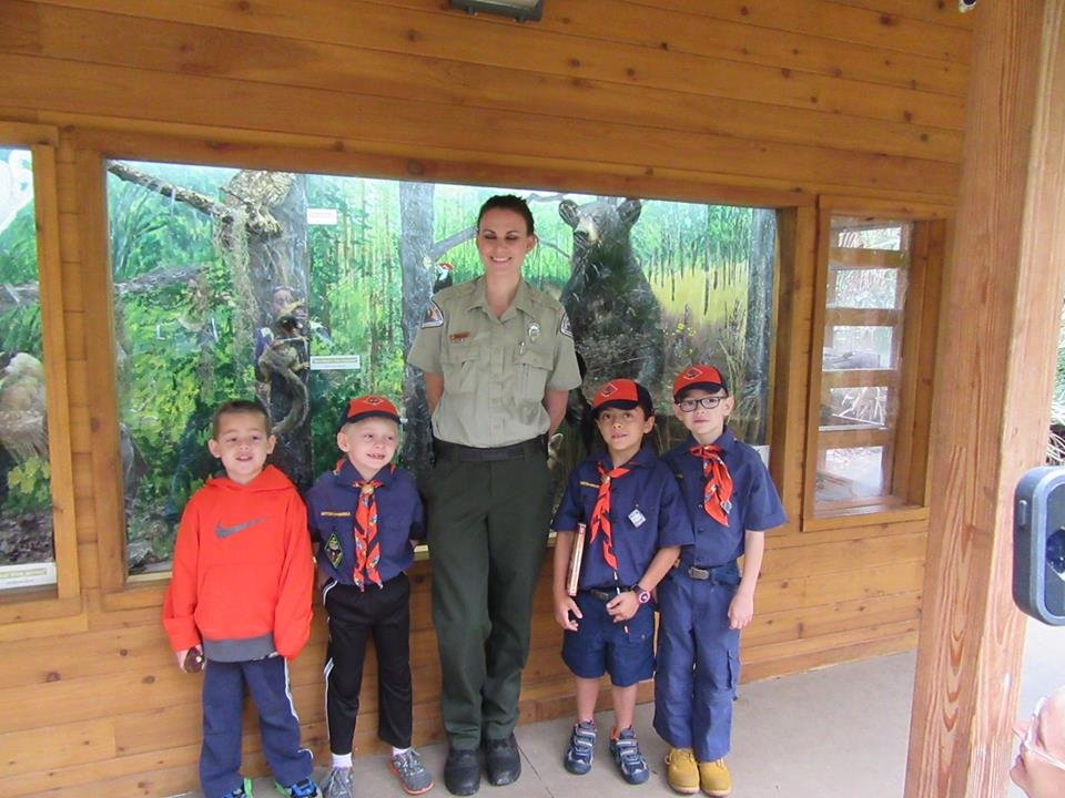 Park ranger posing with Boy Scouts