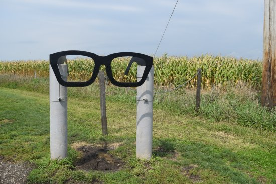 A stainless steel guitar, glasses, and records marks the spot where the plane crashed.