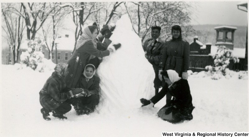 "Storer students build a snowman on campus, likely during the ""Great Snow"" of 1941. Photo courtesy of West Virginia and Regional History Center, WVU Libraries."