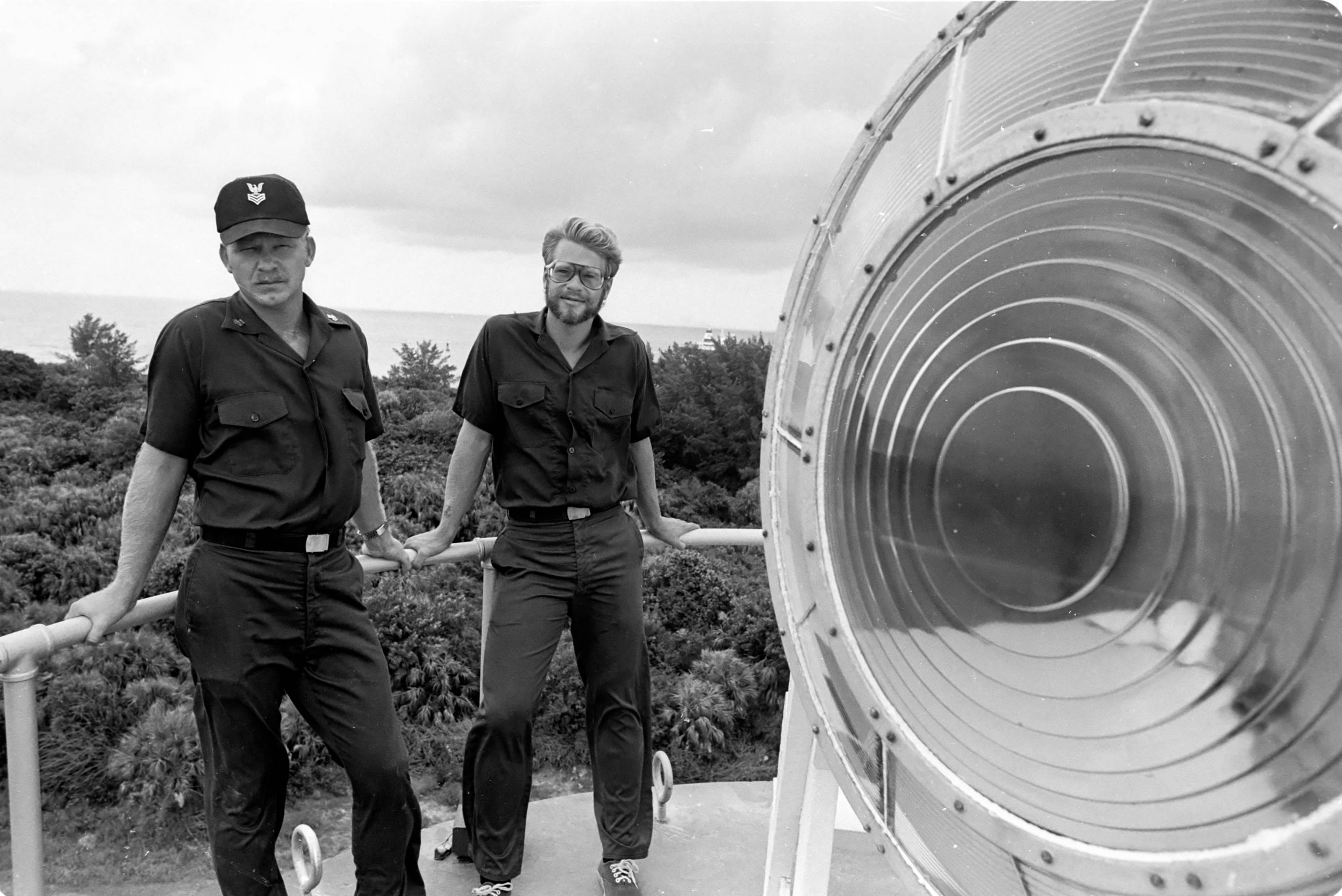 The lighthouse keepers of Egmont Key pose with the light lens (1980)