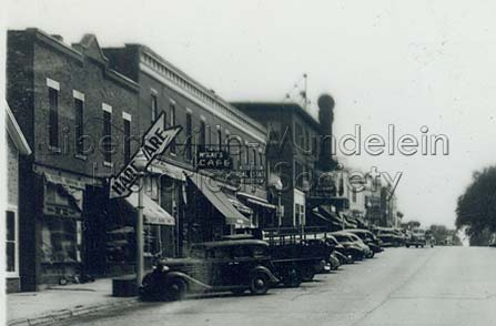Milwaukee Avenue, looking south from Lake Street, Butler Building on the left, circa 1940