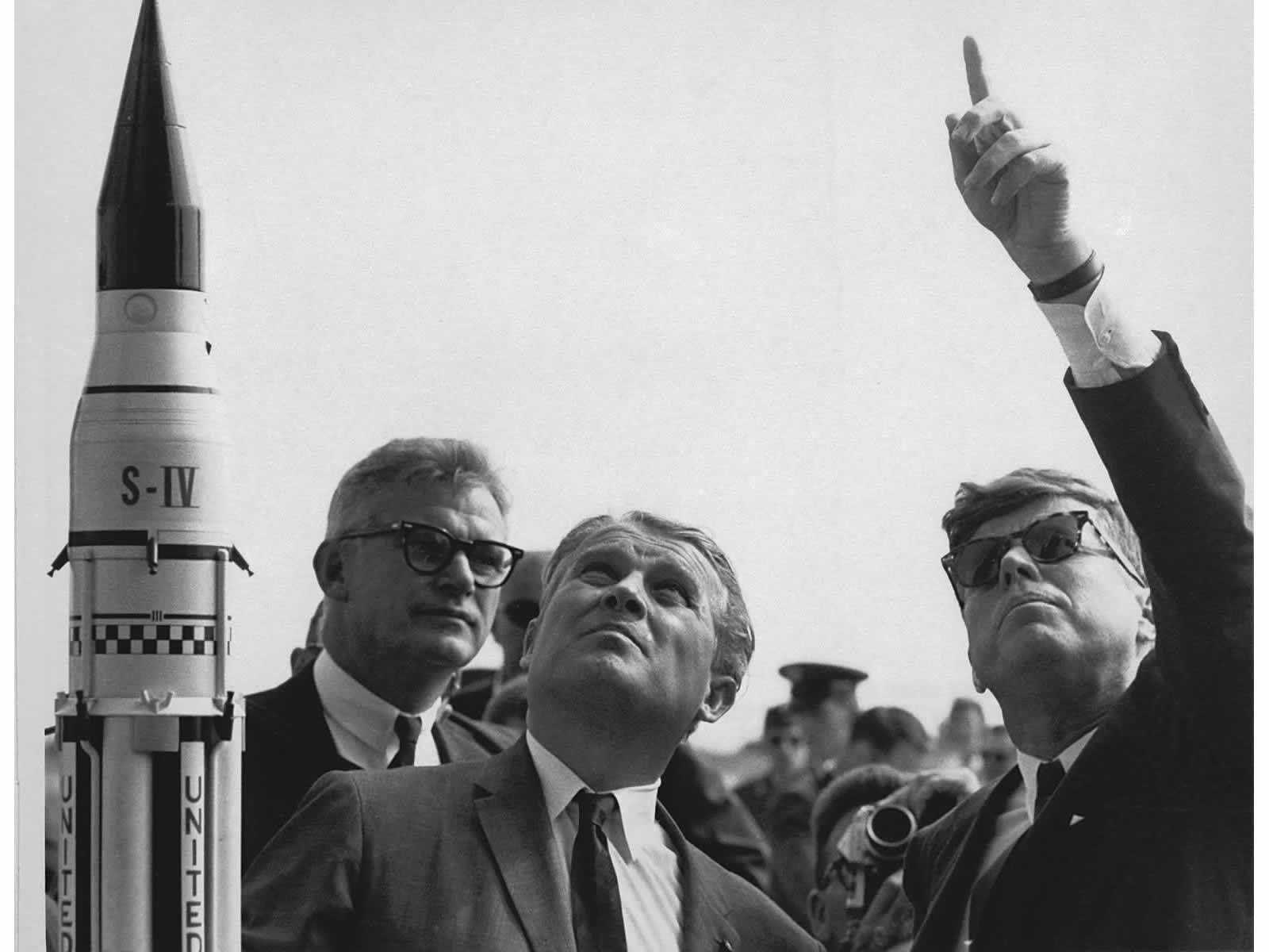 President John F. Kennedy learns about the Saturn launch system from Dr. Wernher von Braun.