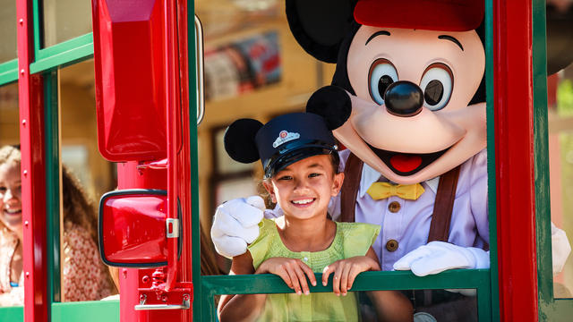This photo shows one of America's most iconic characters, Mickey Mouse exploring Disney's California Adventure Park, image from https://disneyland.disney.go.com/destinations/disney-california-adventure/.