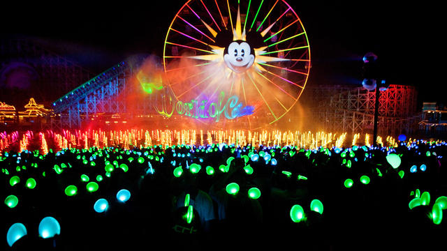 "This photo showcases the Mickey Ferris Wheel located within ""The Boardwalk"" of Disney's California Adventure Park, picture found from https://disneyland.disney.go.com/destinations/disney-california-adventure/."