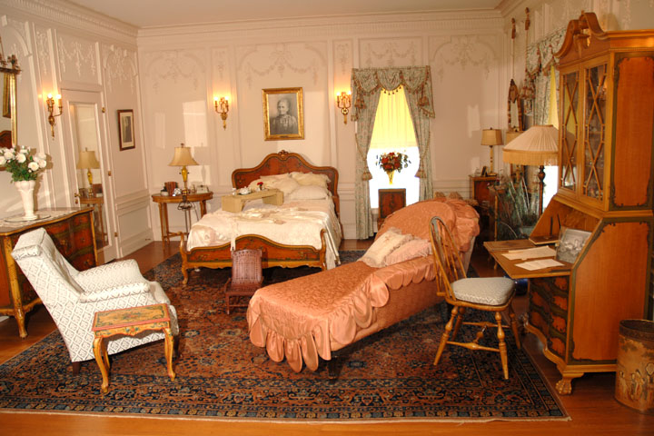 Jane Phillips bedroom features furniture from the early 20th century and a marble-lined tub. Frank's bathroom includes his own barber's chair.