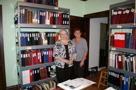Dedicated volunteers posing in one of the archive rooms.