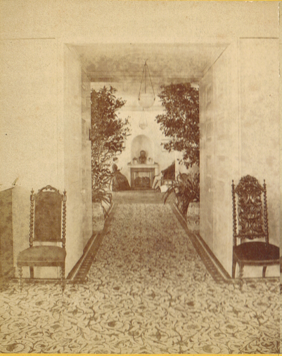 A late 19th century view of the interior, back parlor from the conservatory