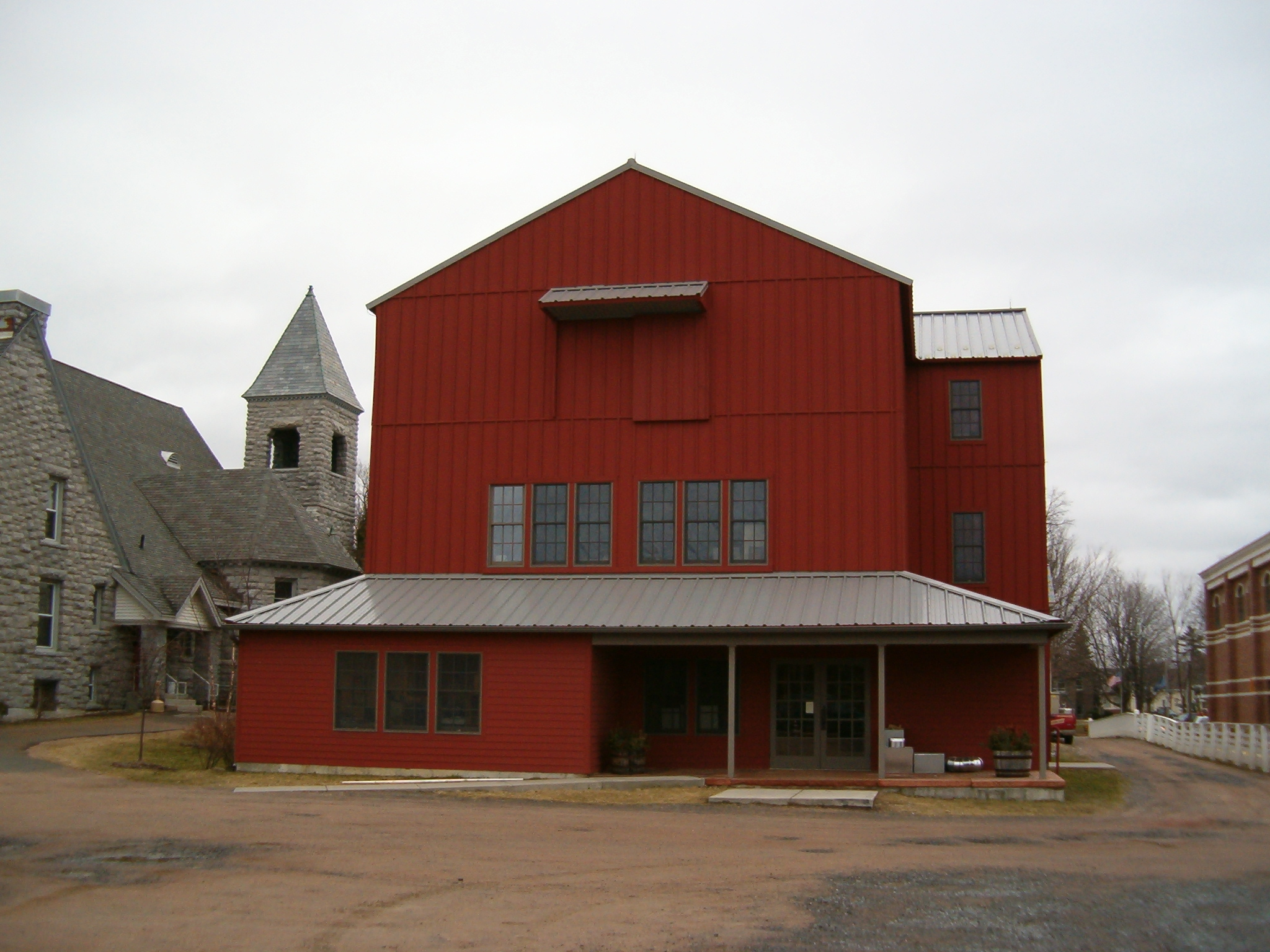 The Red Barn addition and main entrance behind the house.