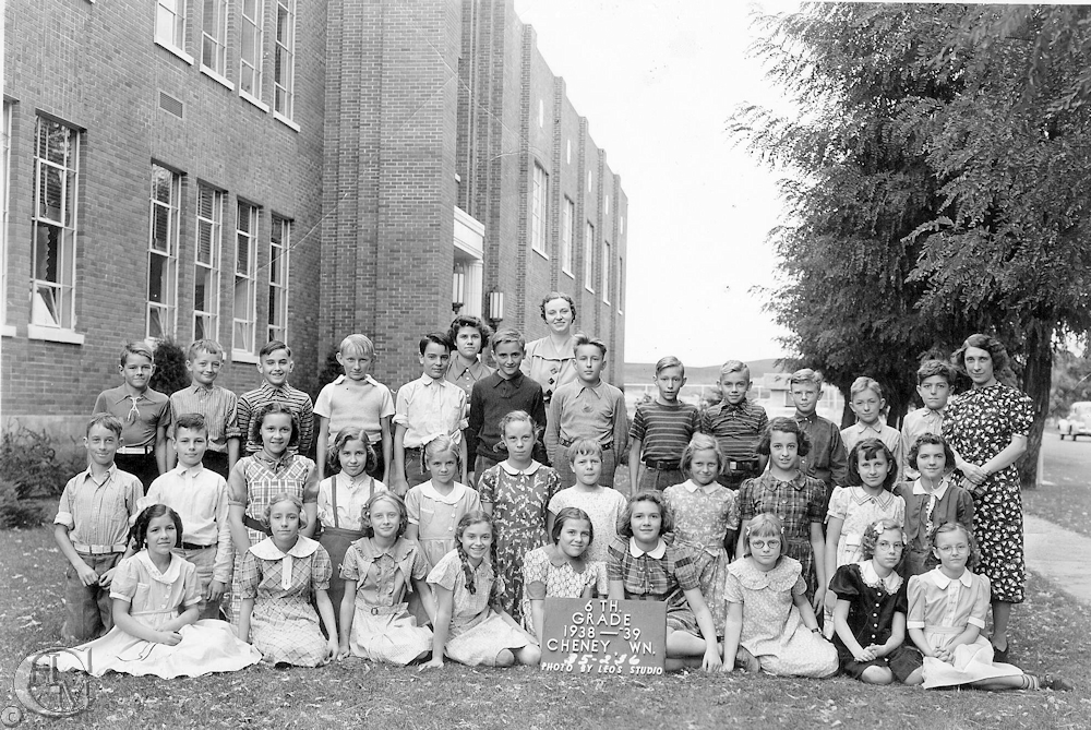 The 6th grade class of 1938-39 standing by the east side of the hall.