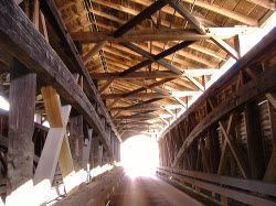 Interior view of the bridge with Burr arch trusses visible