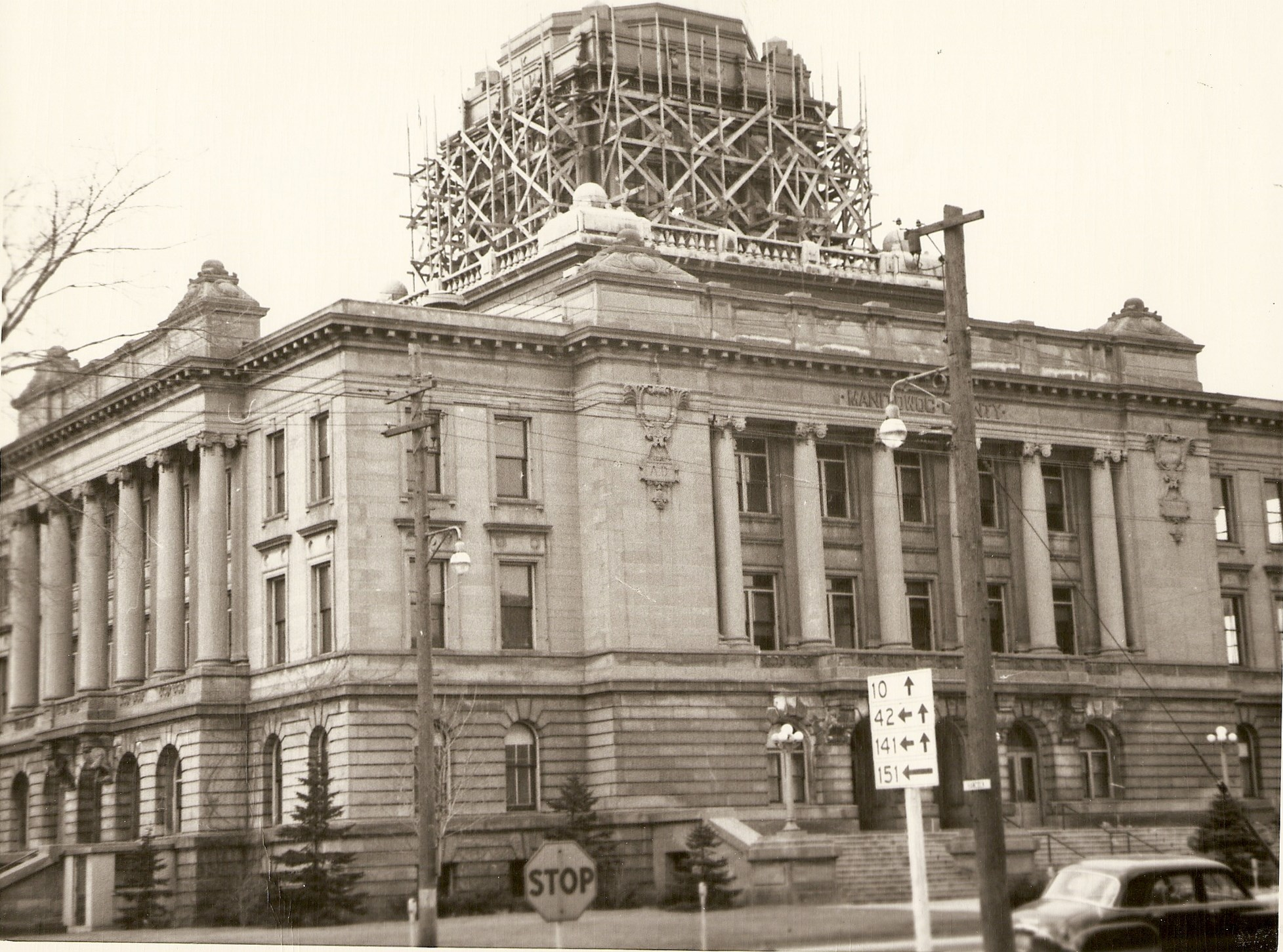 Manitowoc County Courthouse having maintenance done on it in early 1950s.  Looking east side from Hancock & S 8th St.