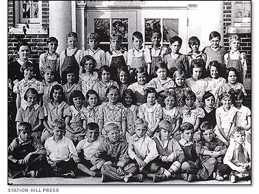 Malcolm's class photo. He is the only African American in the photo, back row, center.