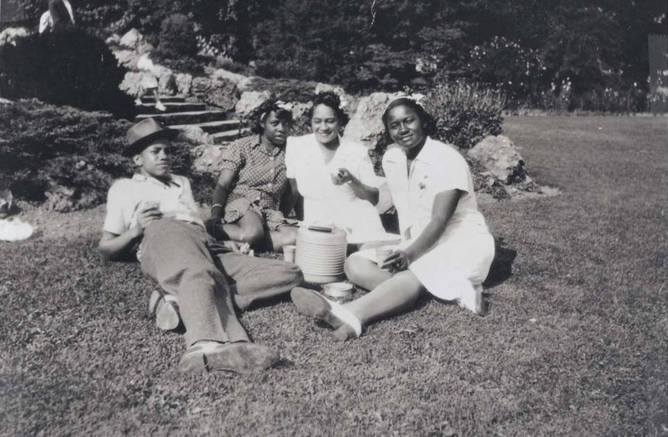 Malcolm, far left, shortly after his move away from Michigan