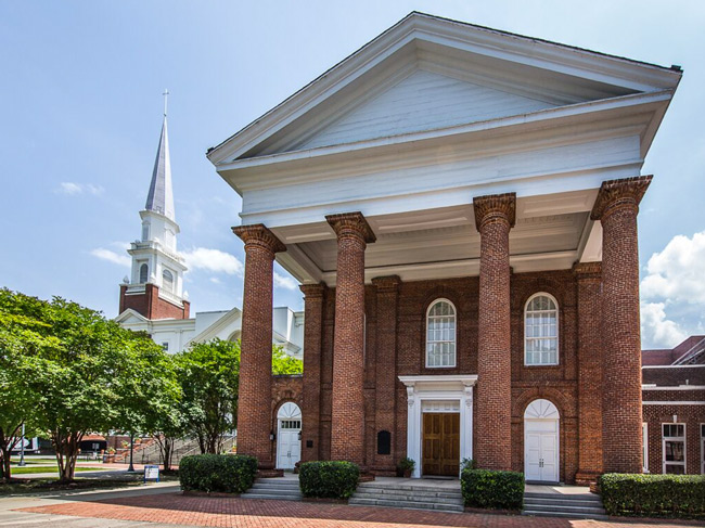 The original First Baptist Church, now the Boyce Chapel. The building with the spire in the background is where service are now held.
