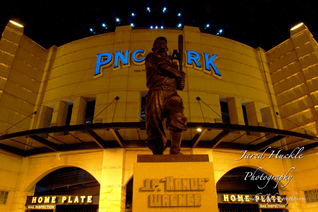 Honus at night with PNC Park in the background.