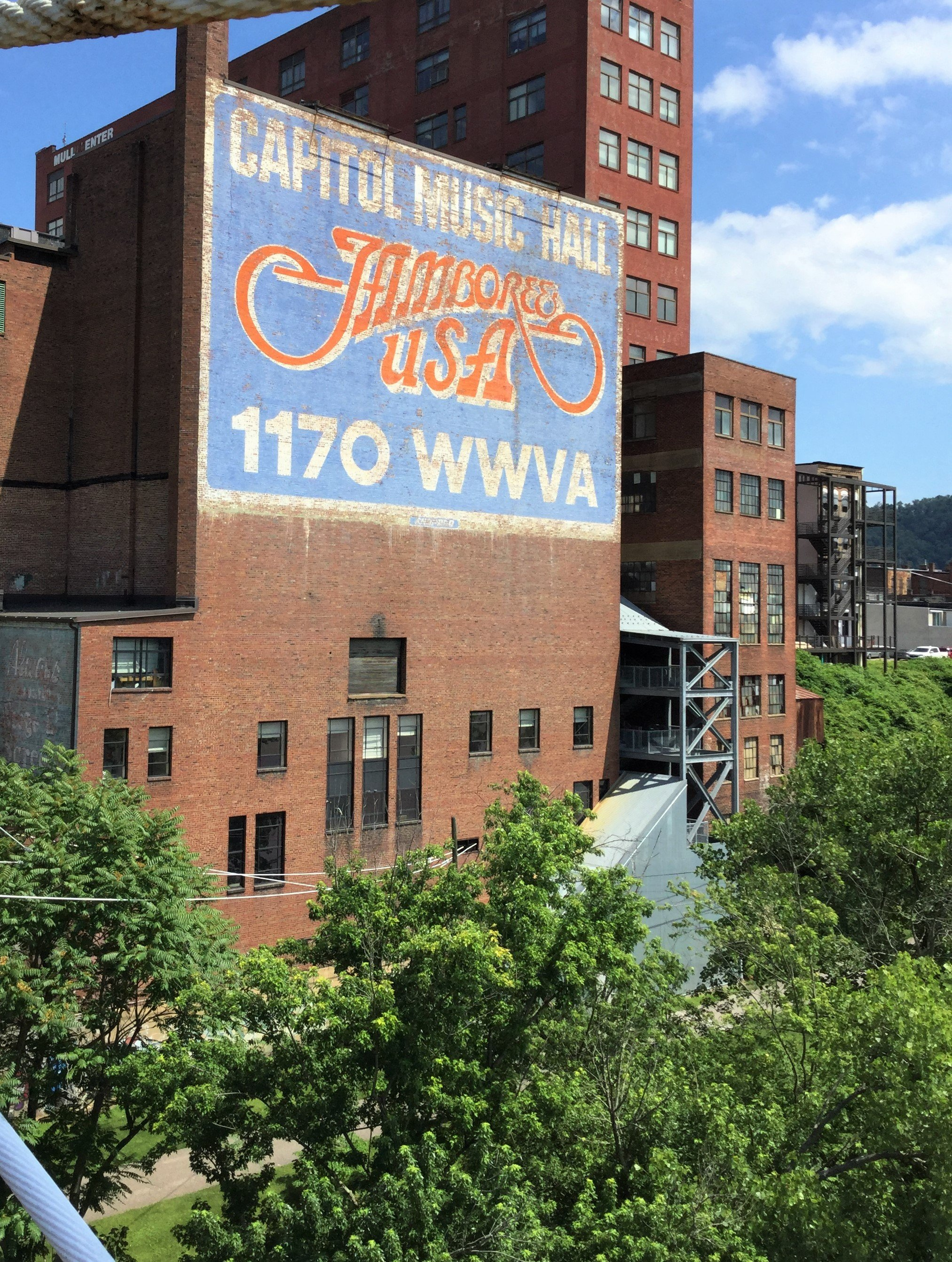 Visitors crossing the suspension bridge into Wheeling see this sign, a reference to the country music radio show first broadcast in 1933 on 1170 am. This 50,000 watt station that covered most of the country east of the Mississippi.