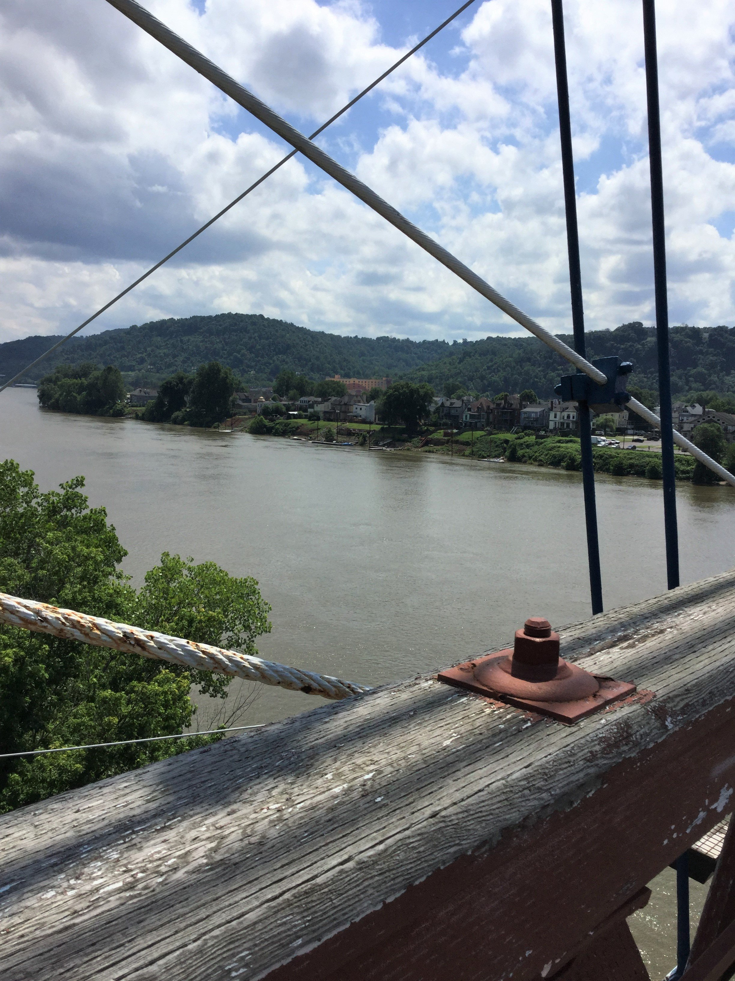 A view of Wheeling Island from the bridge, looking across the Ohio River.